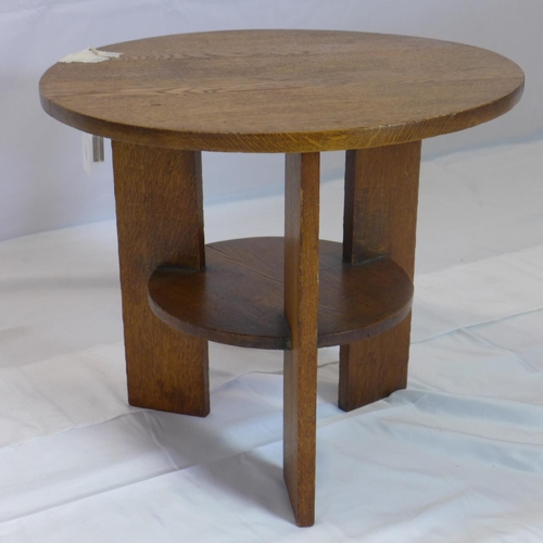 542 - An Arts & Crafts oak lamp table, H.46 D.53cm...