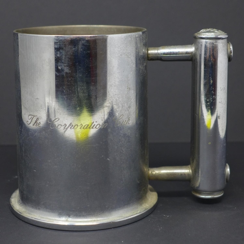 767 - A WWII trench art mug engraved 'The corporation cup'...