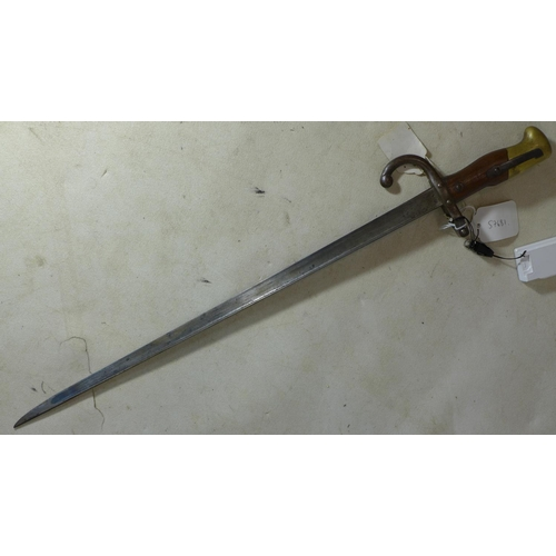 139 - A pre WWI French model 1874 bayonet with steel scabbard, with various markings and inscriptions and ...