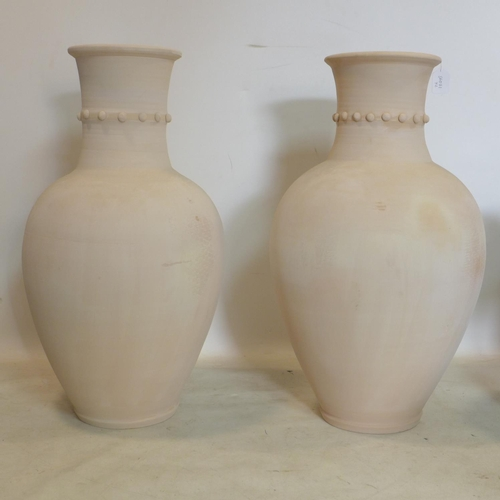 48 - A pair of Persian Hamedan storage pots with studded collars, H.80cm...
