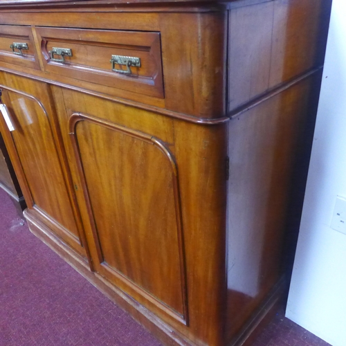 1 - A Victorian mahogany bookcase, 2 glazed doors above 2 cupboard doors, raised on stepped base, H.219 ...