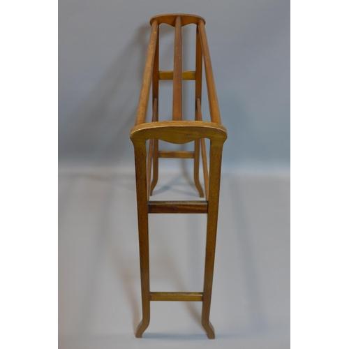 4 - An Art Nouveau inlaid mahogany towel stand...
