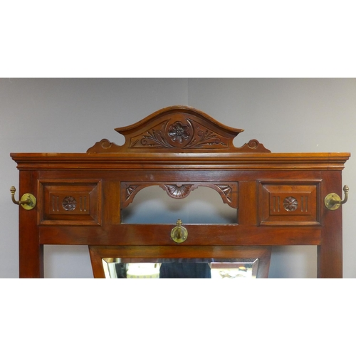 7 - A Victorian Aesthetic mahogany hallstand, having shield mirror with bevelled plate, with single draw...
