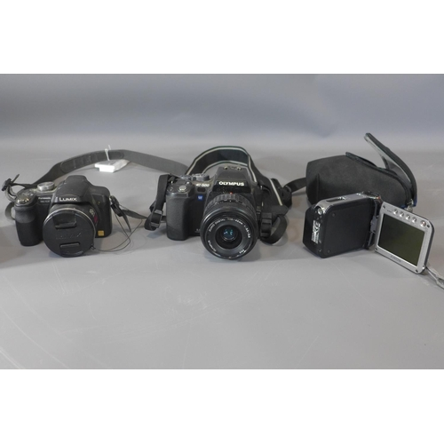 11 - A collection of vintage cameras, to include an Olympus E-500 Digital camera, a Canon EO5 3000 camera...