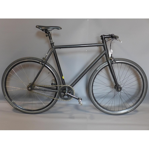 12 - A single speed matte black bike by FIXIE Inc....