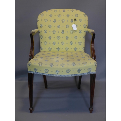 13 - An Edwardian Sheraton Revival armchair with reeded tapering legs...