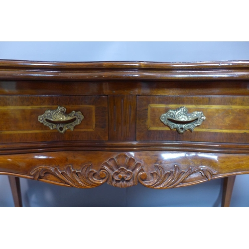 14 - A Queen Anne style walnut serpentine table, with two short drawers, on cabriole legs, H.78 W.118 D.5...
