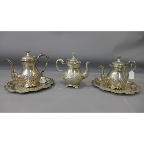 16 - A collection of Middle Eastern silver plated ware, to include teapots, jugs and trays...