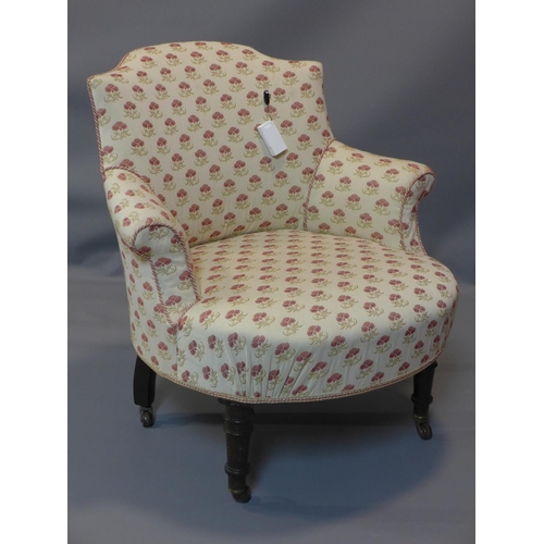 20 - A Victorian bedroom chair, raised on turned legs and castors...