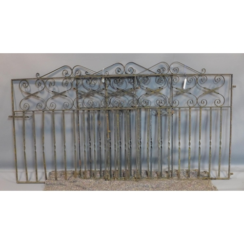 22 - A pair of wrought iron gates and a panel...