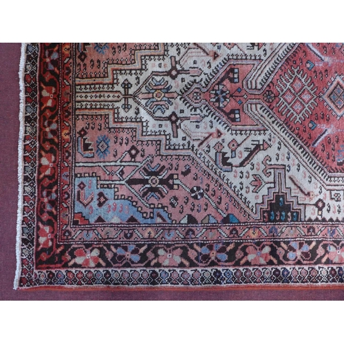31 - A North-West Persian Koliahee rug, central diamond medallion with repeating petal motifs on an ivory...