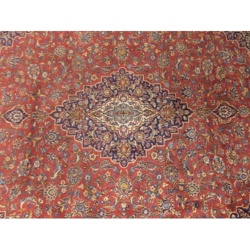 33 - A Central Persian Kashan carpet, central double pendant medallion with repeating spandrels and petal...