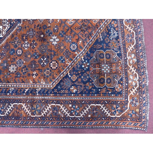 36 - A South-West Persian Qashqai carpet, central diamond medallion with repeating petal and animal motif...