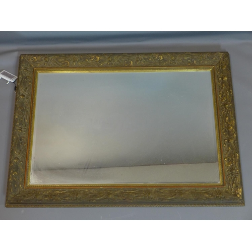 38 - A giltwood mirror with floral border and bevelled plate, 78 x 100cm...