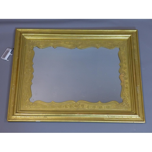 41 - A ornate giltwood wall mirror, with floral border...