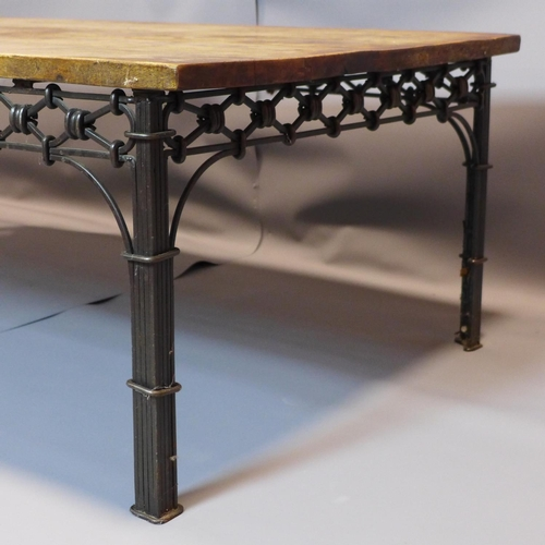 43 - An Indian teak low table, on cast metal supports, H.46 W.135 D.74cm...