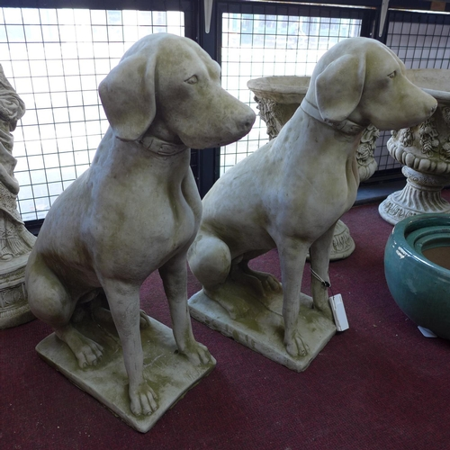 174 - A pair of reconstituted stone seated hunting dogs, H.73cm (2)...
