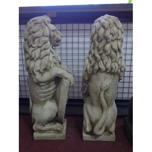 176 - Two reconstituted stone lions with armorial shields, H.77cm (2)...