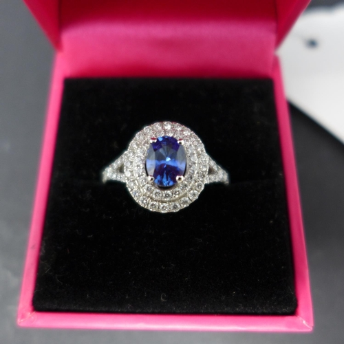 313 - A 18ct white gold, diamond and sapphire ring, boxed...