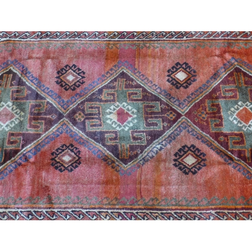 52 - A South-West Persian Qashqai carpet, triple pole medallion on a terracotta field, within stylised ge...