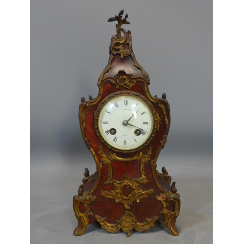 61 - A late 19th century French mantle clock by Maple & Co. Ltd, decorated with ormolu mounts, the white ...