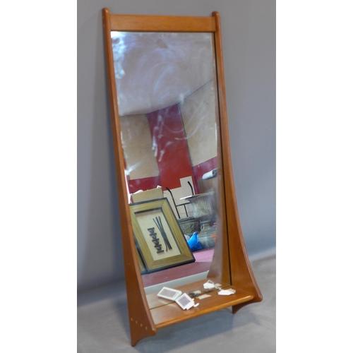 80 - A Danish teak shelved mirror by Pedersen & Hansen, with rectangular glass plate, H.11 W.44 D.17cm...