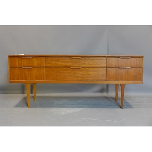 100 - A Danish teak sideboard by Steens, with two central long drawers flanked by four short drawers, on t...