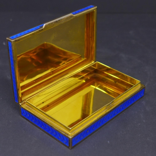 184 - A silver and blue enamelled box, with gilt star design, having gilded interior, marked 925, H.2 W.10...