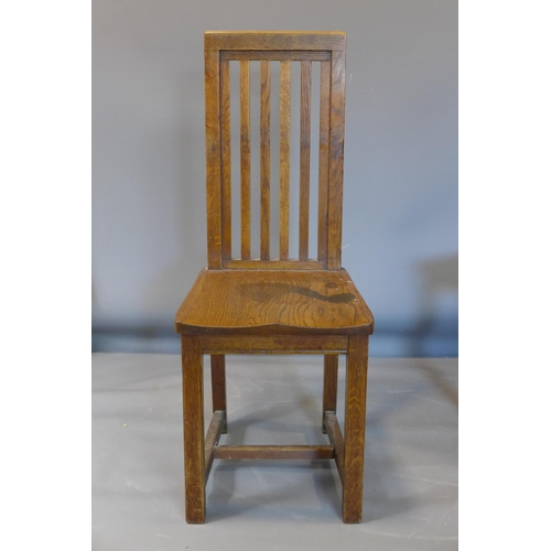 509 - A set of seven late 19th century oak chairs, raised on square chamfered legs (7)...