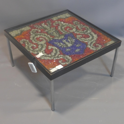 514 - A coffee table with glass armorial crest to top, signed Wanda Kulesza, on square legs, H.40 W.72 D.7...