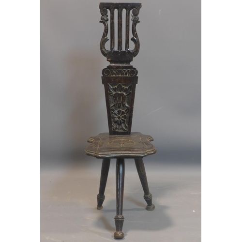 560 - A Victorian oak harp back spinning chair, with carved rosette motif, H.87cm