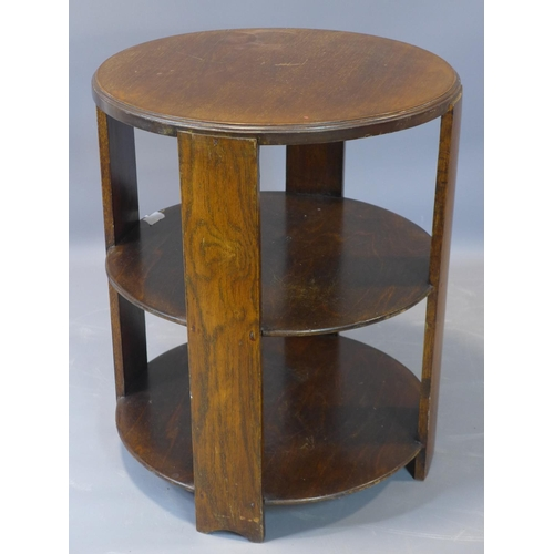 587 - An Art Deco circular mahogany 2 tier book table. H.60 D.51cm...