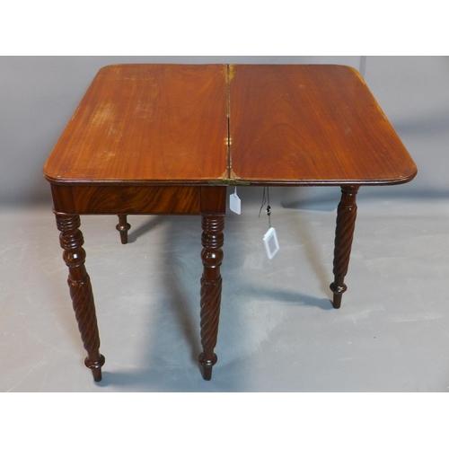 751 - A 19th century mahogany foldover tea table on turned and barley twist legs, H.77 W.89 D.91cm...