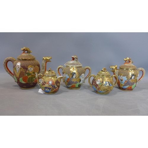 506 - A Japanese Kutani 5 piece dragon ware teaset, with gilt decoration depicting Geisha girls and deitie...