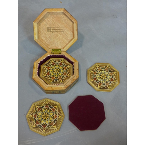 510 - A collection of 20th century Islamic Khatam inlay items, to include a hexagonal cushion shaped box w...