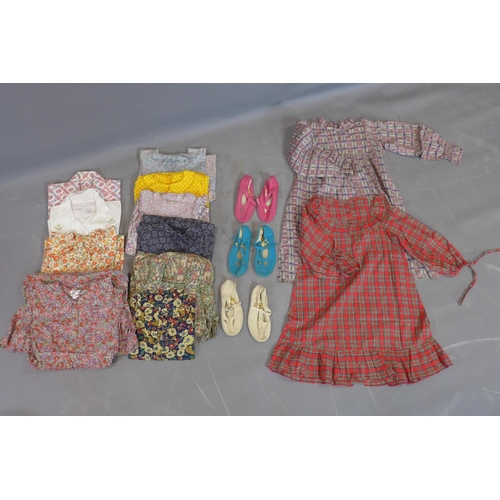513 - A vintage hatbox containing 12 items of 1970's girls dresses and tops, including Laura Ashley and li...