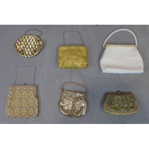 516 - A collection of 12 various antique and vintage beaded and embroidered evening bags, together with a ...