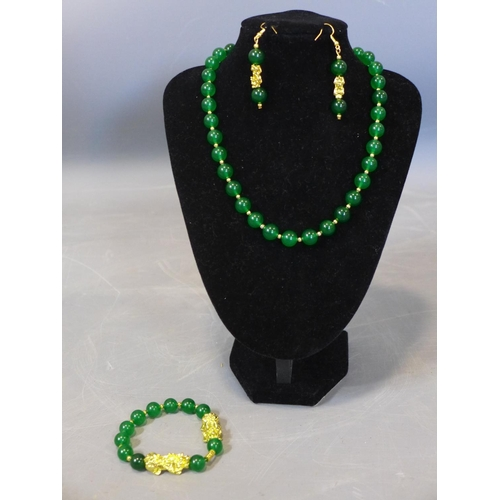525 - A Chinese beaded jade and gold plated necklace, bracelet and earrings...