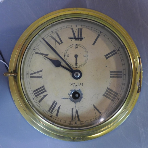 534 - A Ship's Bulkhead Clock, Astral 8 days Marine brass, by Smith, circa 1935...