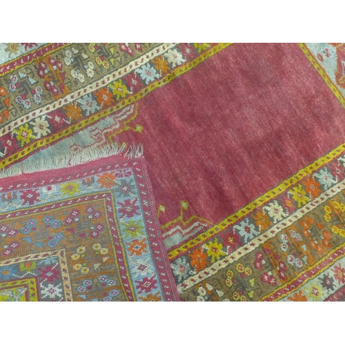 581 - An antique Turkish Ladik rug, with'mihrab' niche within multi-coloured border, 173 x 106cm...