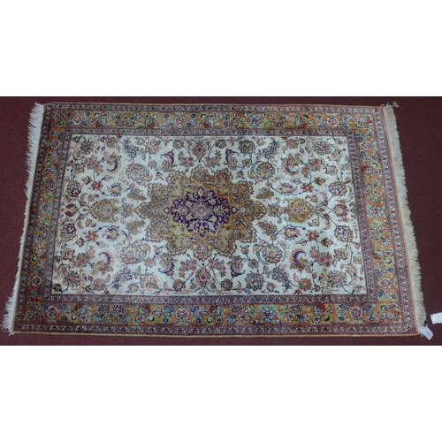 582 - A pure silk Persian Qum rug, central floral medallion with stylised floral motifs on an ivory ground...