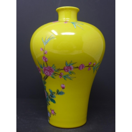 585 - A 20th century Chinese famille rose vase, decorated with birds and blossoming flowers on a yellow gr...
