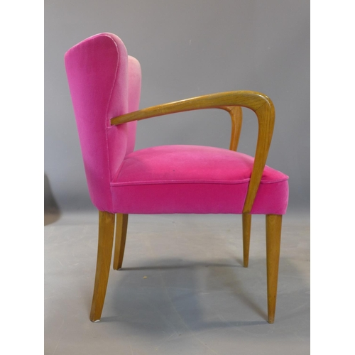 592 - A mid 20th century beech wood chair with pink upholstery...