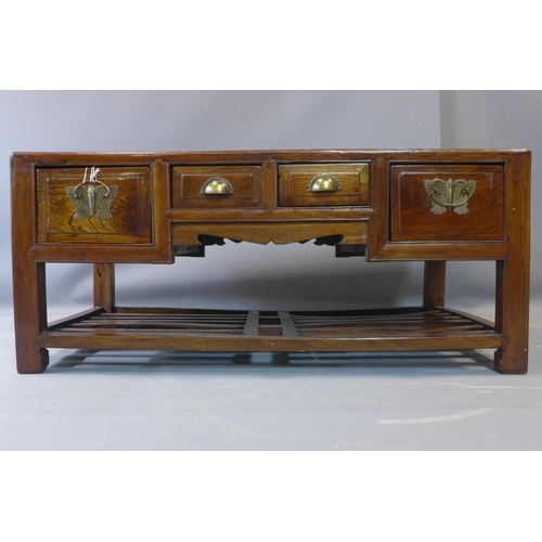 607 - A Chinese elm coffee table, with four drawers, on square legs with under tier rack, H.50 W.115 D.59c...