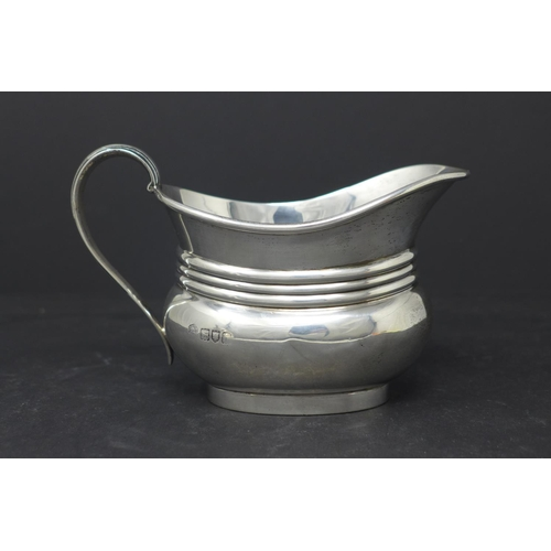 621 - A silver teapot, with Bakelite handle and finial, Sheffield 1904, together with a silver milk jug, b...