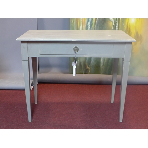 636 - A painted side table fitted with frieze drawer on square tapering supports. H.77 W.91 D.47cm...