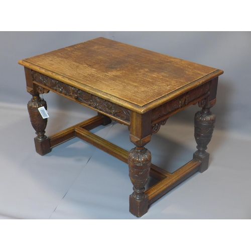 20 - A Victorian oak centre table with one drawer, having carved frieze panels, on baluster supports join...