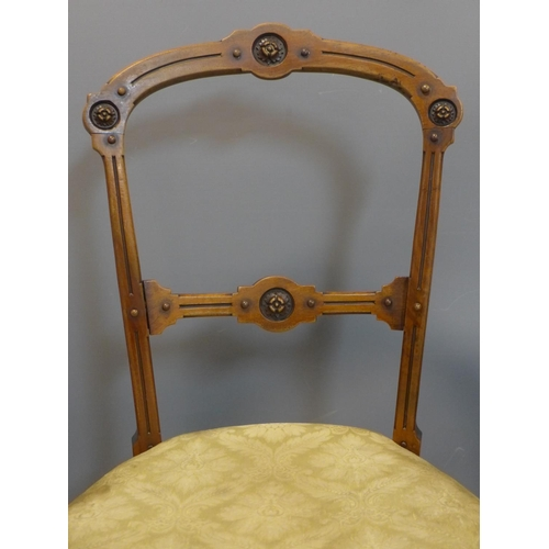 21 - A set of six Victorian mahogany parlour chairs, with rosette design to frame, having floral upholste...