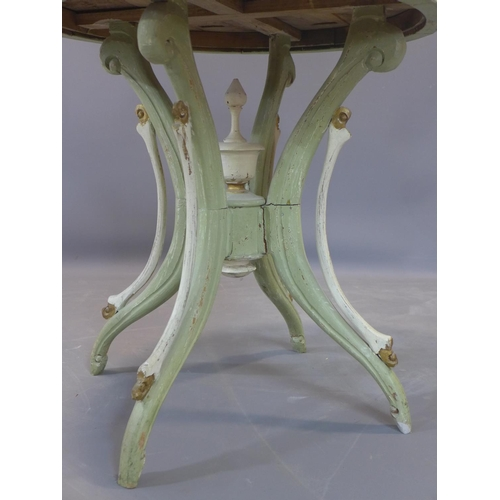 24 - A distressed painted circular table, on outswept legs, H.69cm Diameter 69cm