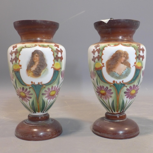 179 - A pair of late Victorian Bohemian opaque glass vases with hand painted vignettes of ladies and styli...